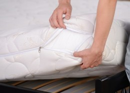 Demonstration of quality. A young man holding demonstrations quality mattress in the bedroom; Shutterstock ID 214040800; PO: Today.com David Anderson