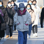 Mask-wearing people are seen at a street in Beijing, China on March 4, 2020, amid an outbreak of the new coronavirus COVID-19. The number of the new coronavirus COVID-19-hit patients has reached to 80,026 and the death toll has been confirmed 2,912so far as of March 2nd, in China. ( The Yomiuri Shimbun via AP Images )